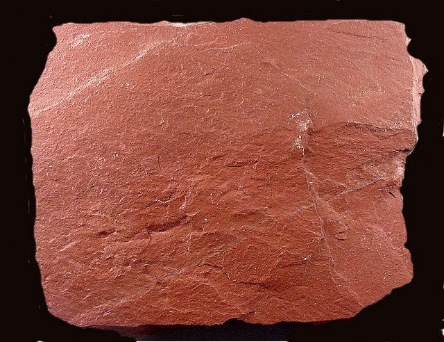Red Shale Stone : Shale by breaking into very flat thin sheets when struck